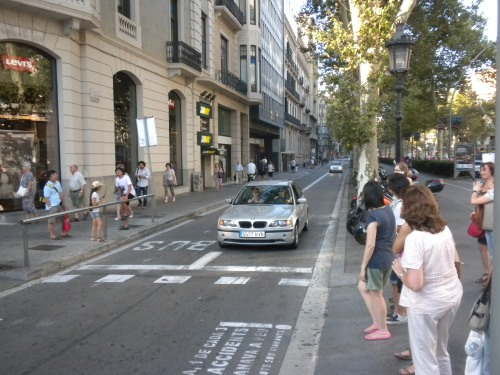 A small side lane on a large boulevard in Barcelona.